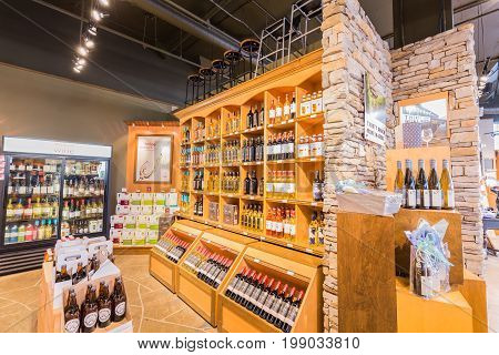 Toronto, Ontario, Canada,  wine store, June 16, 2017, great, nice closeup view of various wine on wooden shelf's inside wine store in Toronto down town area