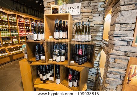 Toronto, Ontario, Canada,  wine store, June 16, 2017, great, nice closeup view of various delicious  wine on wooden shelf's against stone wall  inside wine store in Toronto down town area