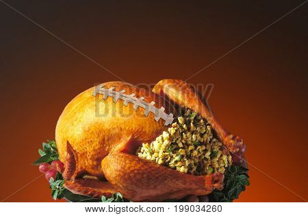 Roast Turkey with football laces, Thanksgiving Holiday football concept.