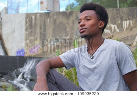 pensive young man portrait outside looking tranquil scenic contemplation