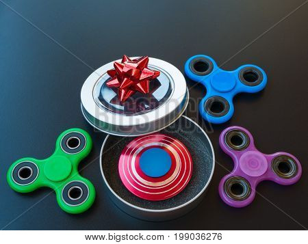 Popular colourful fidget spinner toy in a gift box on a black background.