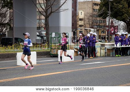 NAGOYA JAPAN - MARCH 13ม 2016: Nagoya Women's Marathon 2016. Women's running in the downtown. Course Start and finish at Nagoya Dome Distance 42.195km. Nagoya city Japan.