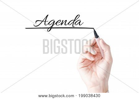 Hand writing Agenda with black marker on transparent board.