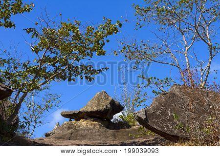 Stone and blue sky at Phu Pha thoep National Park Mukdahan county of Thailand