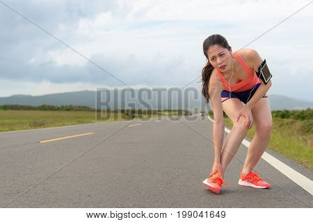 Young Beautiful Jogger Running On Road Too Tired