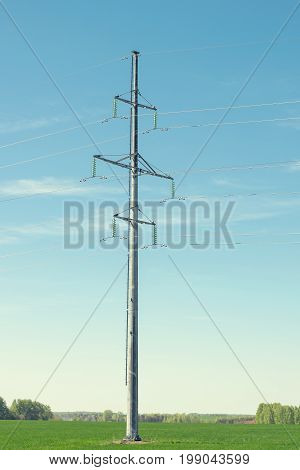 Support high-voltage power line on blue sky background. Equipment for transmitting electric current of high voltage.
