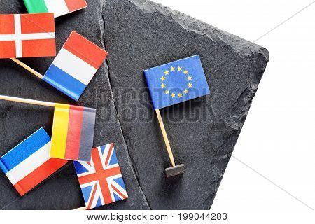 Political concept with flags of the European Union. Flags of European countries separated by crack from flag of the European Union.