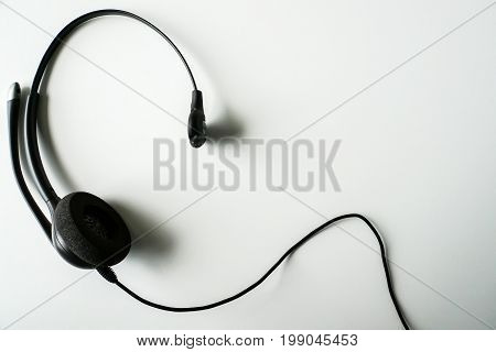 isolated close up black headset for call center unit
