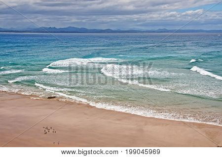 A Beautiful Wild Unexplored Paradise Ocean Beach With Transparent Water And Clean Sand, Waves And  S