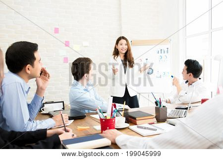 Asian business woman leader conducting company sales presentation in the meeting