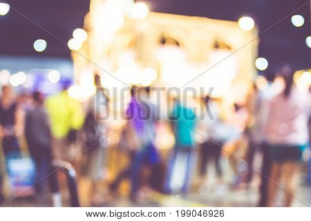 Blurred Background: Crowd Of People In Expo Fair With Bokeh Light ,vintage Filtered