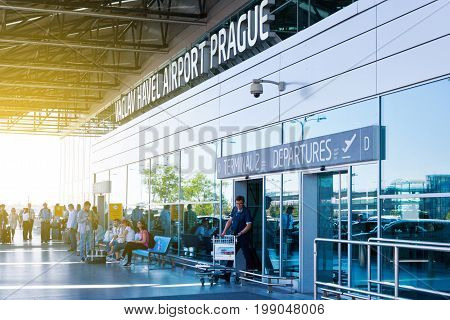 PRAGUE CZECH REPUBLIC - AUGUST 31 2016: Vaclav Havel International airport Ruzyne Czech republic. Sihouette of people travelling by air in departure hall.