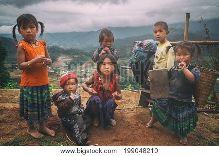 MUCANGCHAI, VIETNAM, MAY 24: H'mong ethnic minority children on May 24, 2017 in Mucangchai, Vietnam. H'mong is the 8th largest ethnic group in Vietnam.