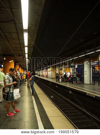 Munich,Germany-August 07,2017: People wait for a suburban train to arrive at the Marienplatz Station