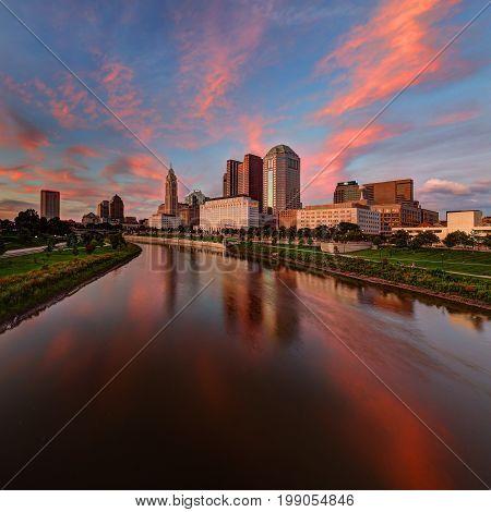 Evening Columbus Ohio skyline along the Scioto River at dusk