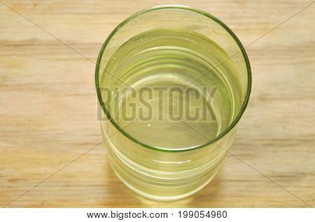 clear freshwater in glass on wooden board