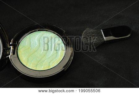 blusher powder cartridges and blush on black fabric background