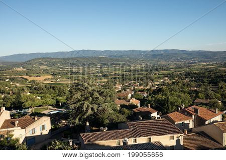 Panoramic view of cultivated fields vineyards and mountains in Provence France