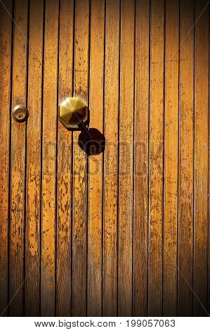 Gold door knob on old wood door