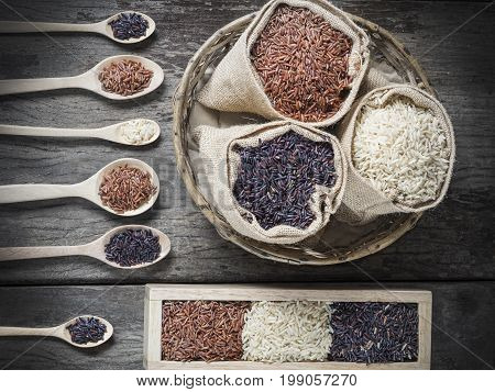Healthy Organic Rice: Riceberry Rice and Brown Rice on wood background