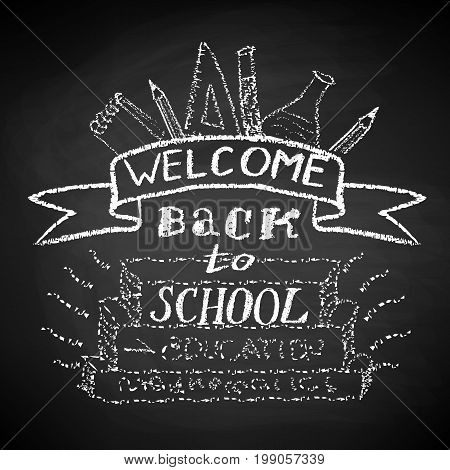 Welcome Back to School. Chalk text and drawing on blackboard.