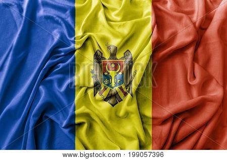 Ruffled waving Moldova flag national flag close