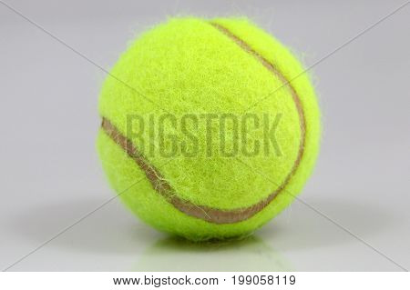 Tennisball on white background with a shadow