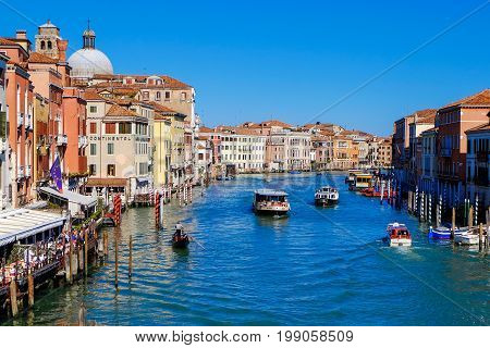 Venice, Italy - March 29, 2015: Tourist visiting Venice using gondolas and water buses to explore the Canal Grande in Venice, Italy, in March 2015