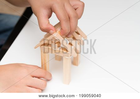 kid making a house model at home