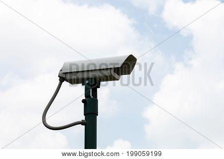 Security camera on blue sky background., Cctv cam
