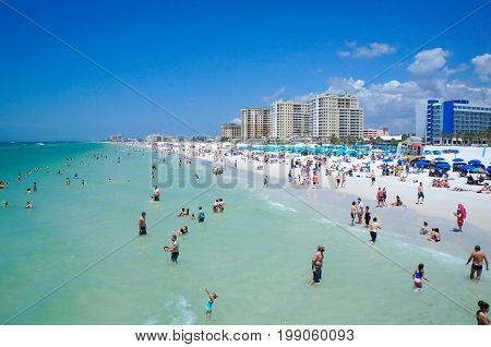 People enjoying water, beach, skyline in Clearwater Beach Florida, Spring Break, April 23, 2017