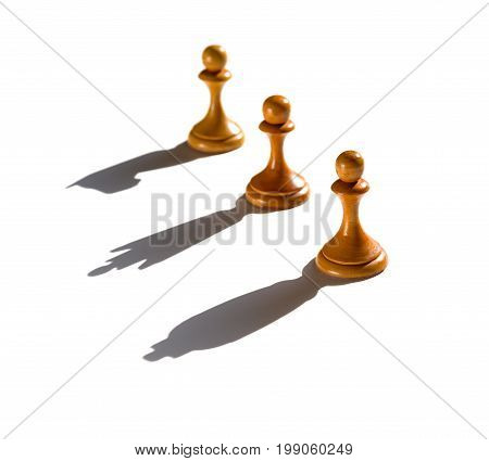 three chess pawn casting Queen King and Knight shadow concept of strength and aspirations