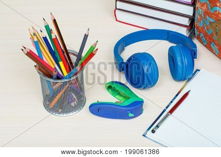 School Supplies. School Backpack, Books, Metal Stand For Pencils With Color Pencils, Stapler, Headph