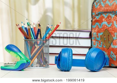 School Backpack With School Supplies. Books, Stand For Pencils With Color Pencils, Stapler And Headp