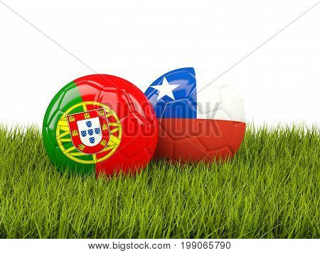 Portugal And Chile Soccer Balls On Grass