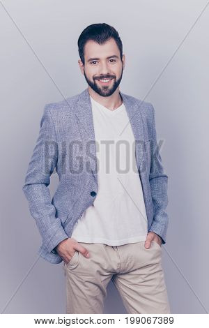 Young Successful Brunet Bearded Entrepreneur In Casual Smart Is Standing On A Pre Light Blue Backgro
