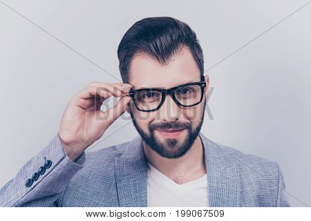Successful Young Handsome Brunet Bearded Businessman In Formal Outfit And Black Glasses On Pure Back