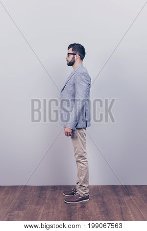 Side Profile Full Size Photo Of High School Professor In Smart Casual, Standing Near Grey Wall, In G
