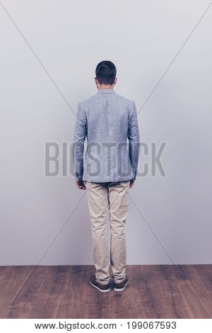 Snap Model Shot. Full Length Photo, Rear View, Guy In A Formal Wear, Stands On A Wooden Floor, Near