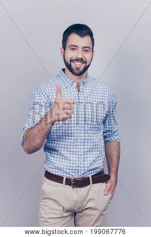 Success Concept. Stylish Young Smiling Bearded Brunet Is Standing On Pure Gray Background In Smart C