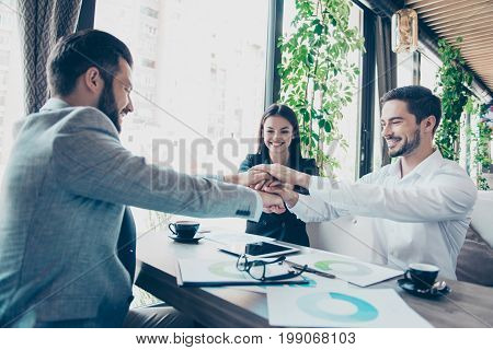 Conception Of Successful Teambuilding. Cheerful Partners Putting Their Hands On Top Of Each Other At