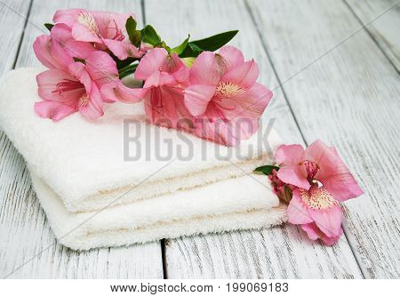 Spa Towels And Alstroemeria Flowers