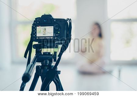 Focused View Of Video Camera, Recording Pretty Brunette Girl Blogger, Talking, Sitting At The Floor