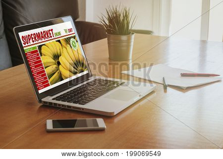 Supermarket online shop website in a laptop screen at a workplace