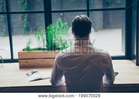 Rear View Of A Brunet Journalist Stylish Guy In White Classic Shirt, Writing A Story In A Workplace