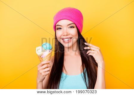 Cheerful Young Korean Lady Looks At The Camera, Holds Tasty Ice Cream Of Three Scoops Of Different F