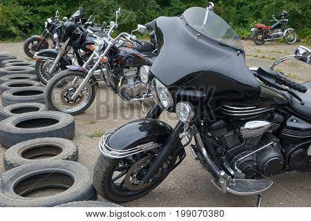 CHERNIVTSI, UKRAINE - JULY 22, 2017: Several retro motorcycles at the festival Moto-picnic Retrodrom 2017