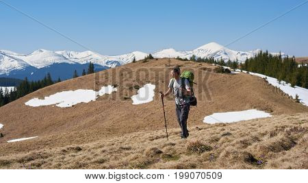 Full Length Shot Of A Male Tourist With Hiking Equipment Walking Mountains Enjoying The View Copyspa