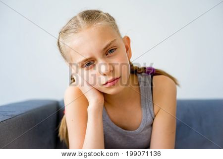 Ill girl is suffering from a toothache
