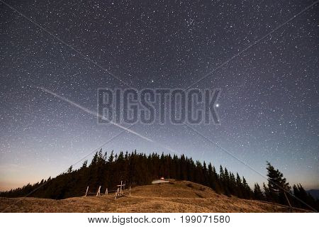Shooting Star In The Night Sky Above Forest And Mountains Outdoors Dark Blue Galaxy Astronomy Space